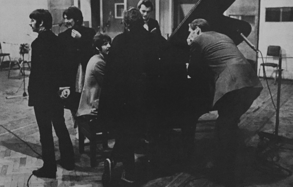 Watched by musical scholar George Martin (right), the new Beatles prepare to record. From left, Ringo Starr, George Harrison, Paul McCartney (seated) and John Lennon (back to camera) in London EMI Studios