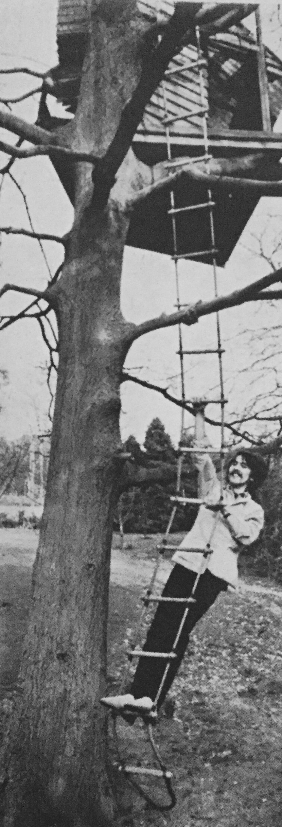 At Ringo's home, the Beatles social centre, George climbs up to the tree house where Ringo likes to sit and think.