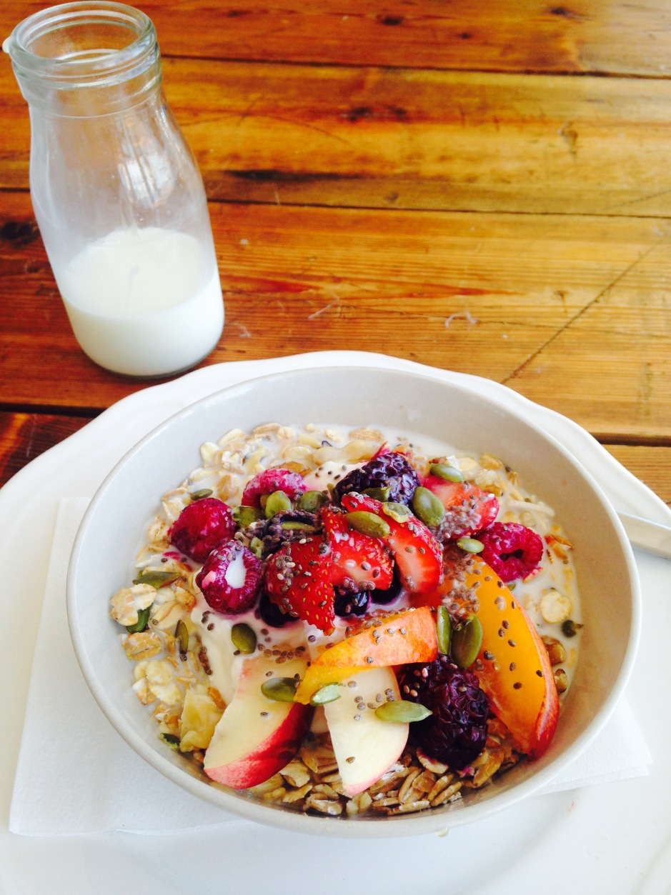 Muesli with fresh fruit and nuts - FOLKLORE CAFE