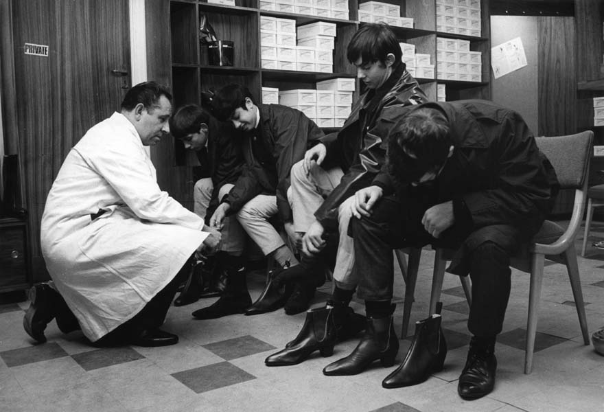 Mods trying on their newly made Beatle Boots at Anello & David